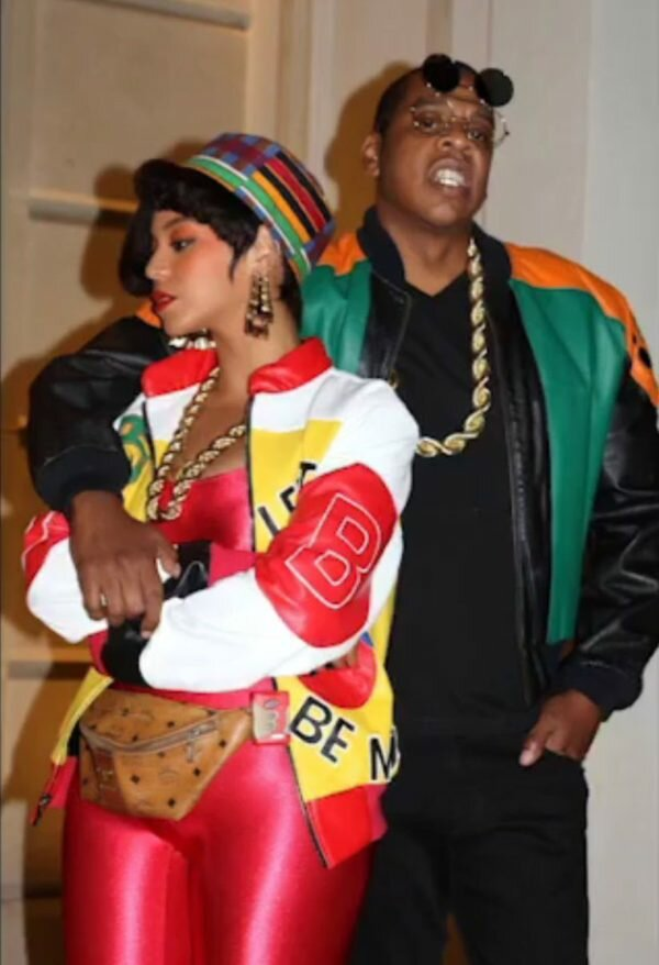 Jay Z got in on the 90s fun with his jacket and gold chain.